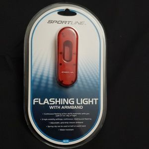 Flashing light with arm band